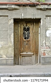 Hidden treasures of Sololaki district: old decadent wooden door. Center of Tbilisi, Georgia