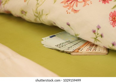 Hide money under the pillow in bed