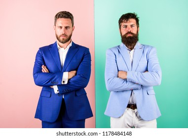Hide real emotions. Business partners or boss and employee in suits with tense faces. Businessmen with stylish appearance in jacket pink blue background. Tense face expression of business partners.
