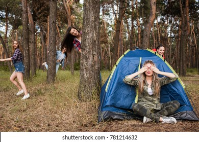Hide and seek tourist leisure games concept. Woman friendship. Spending time together.