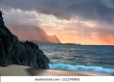 Hideaway Beach during a stormy sunset, Kauai, Hawaii