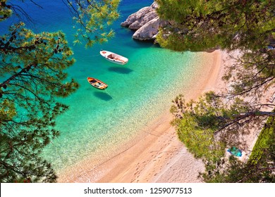 Hiden beach in Brela with boats on emerald sea aerial view, Makarska riviera of Dalmatia, Croatia