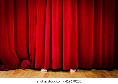 Hiding behind Red Curtain