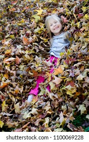 Hiding in the leaves, or just jumping in a huge pile that has just been raked up, These are the best days of fall for this little girl