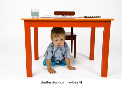 Little Girl At A Kitchen Table