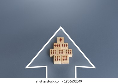 A hierarchical group of people blocks a single formation in an arrow. Unification to achieve the goal. Organization cooperation. Strength in unity, teamwork. Leader, leadership qualities skills