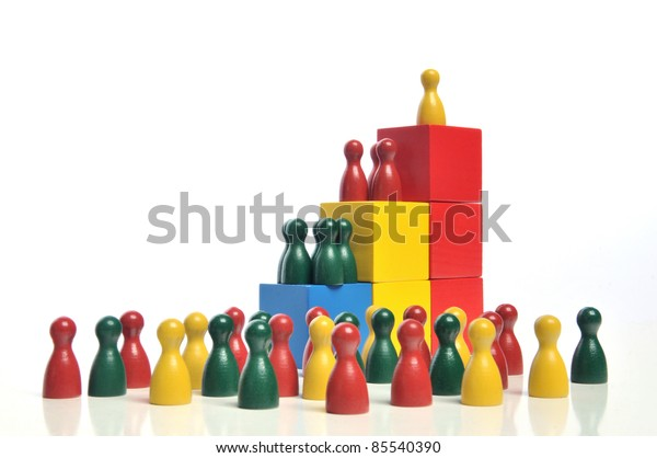 Hierarchy - Multicolored wooden toy blocks and figures on white background