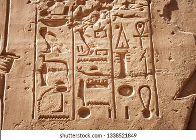 Hieroglyphic carvings in Karnak temple ruins, Luxor, Egypt.