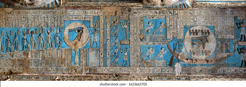 Hieroglyphic carvings and paintings on the interior walls of an ancient egyptian temple