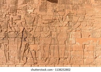 Hieroglyphs of Nubian egyptian gods. Egyptian inscriptions and mural drawing, ancient Nubian kingdom art. Sudan Naga, Meroe, Kerma, Kerima. Sahara desert in Sudan near Nile river