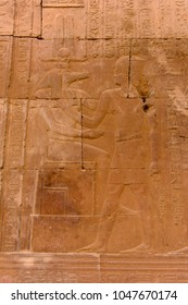 Hieroglyphs of the Temple of Kom Ombo dedicated to the crocodile god Sobek and the falcon god Haroeris, sundown, Egypt.