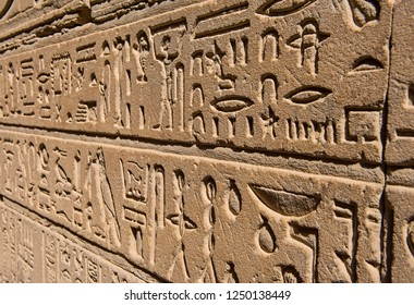 Hieroglypic carvings on wall at the ancient egyptian temple of Horus in Edfu