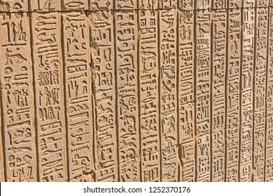 Hieroglypic carvings on wall at the ancient egyptian temple of Kom Ombo