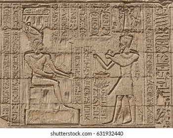 Hieroglypic carvings on wall at the ancient egyptian temple of Khnum in Esna