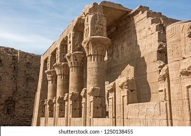 Hieroglypic carvings on wall and columns at the ancient egyptian temple of Horus in Edfu