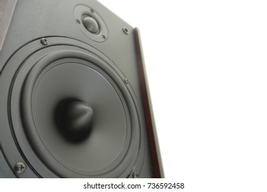 Hifi gold and black loud speaker box in close up.Professional audio equipment for dj,musician,party. High quality sound recording studio equip.Focus on hi-fi diffuser bullet in wood cabinet box.