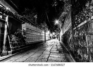 "Higashiyama Hanatouro at Ishibe Alley in Higashiyama district, Kyoto, Japan. Hanatouro means ""flower and lantern road"". Monochrome photo."