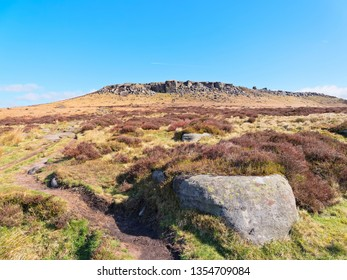 Higger Tor in the Derbyshire Peak District on a bright spring morning