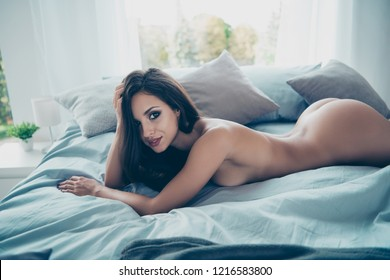 High above angle top view of beautiful lady without underwear lying on soft bed alone in cozy house with modern interior