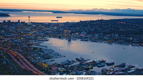 High Above City of Seattle Lake Union Puget Sound San Juan Islands Olympic Mountains Orange Sunset Sky Glowing Clouds Ships Ferry Waterfront