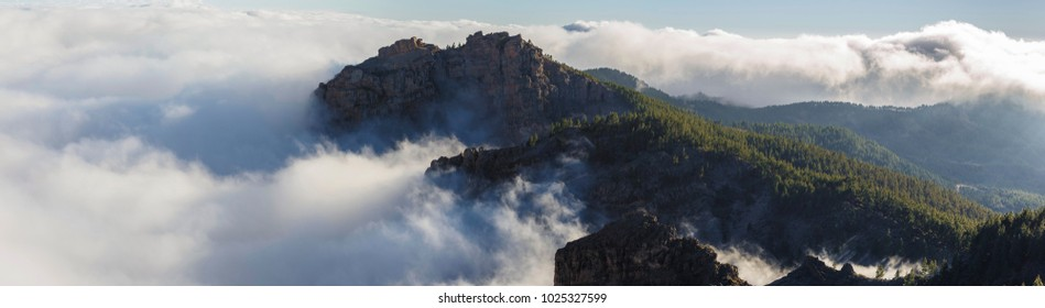 High above the clouds, as they are moving through the mountains of Gran Canaria, Spain.