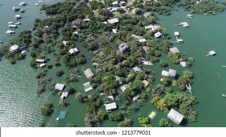 High above flood zone , aerial drone view looking down on natural disaster along Colorado river massive flooding and entire neighborhood under water