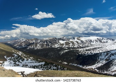 High above the Rocky Mountains with snow capped peaks.