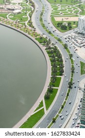 High above view of Sharjah city embankment and road