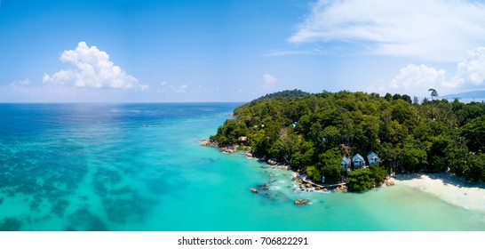 High aerial panoramic view of tropical beach and rocky coast with crystal clear turquoise water on Thai island, Ko Lipe