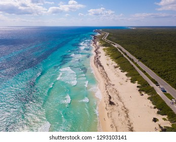 High aerial shot of beaches and island of Cozumel, Mexico with turquoise water.