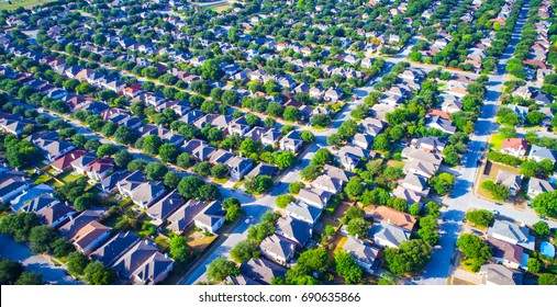 High aerial view above suburb suburbia house mania over Austin Texas USA homes and rooftops colorful summer view