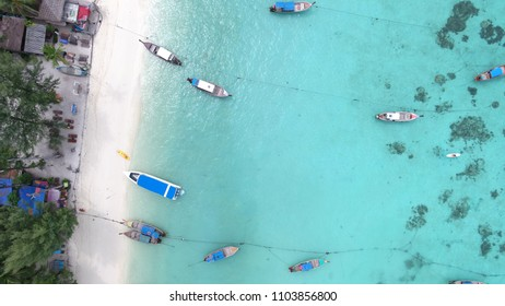 High aerial view of sunrise beach, the most activity of koh lipe transport swimming snorkelling and long tail boat with crystal clear turquoise water on LIPE island,satun,Thailand