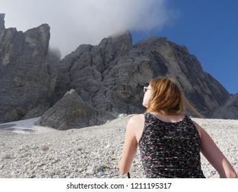 High Aims, Teenage girl up at steep rockface from below
