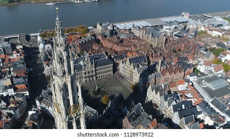 High altitude aerial photo of Antwerp City center showing Onze-Lieve-Vrouwekathedraal the Grote Markt Great Market Square the Brabo Fountain the City Hall the Guildhouses and Scheldt River