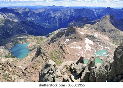 High altitude clear alpine lakes in the Rocky Mountains, as viewed from a mountain summit above.