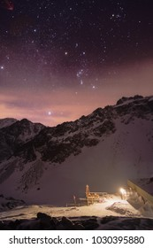 High altitude mountain hut in winter in the night under the stars in High Tatras national park, Slovakia
