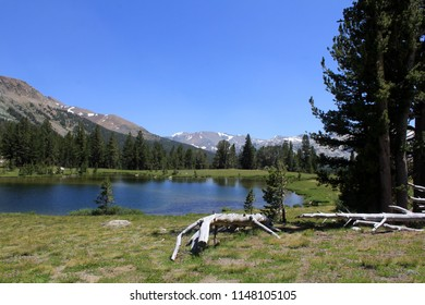 High altitude pond with mountains and a clear blue sky