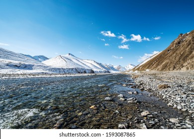 High altitude river and snow mountain background, Xinjiang, China