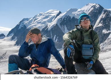 High altitude sickness. Climber holds his head because of headache.