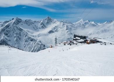 High altitude ski resort in Caucasus mountains. Winter alpine view.