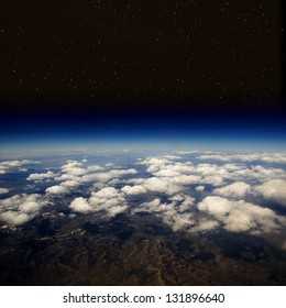 High altitude view of the Earth in space with stars. The desert in the western United States.