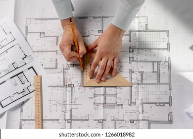 High angle above top flat lay view cropped lady in her formal wear she stand at the table hold tool instrument in hands create new space in interior