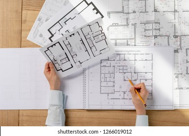 High angle above top view cropped collar profession occupation lady in her formalwear shirt she sit desk in light loft interior inspect read prepare analyzing expertise technical property draw
