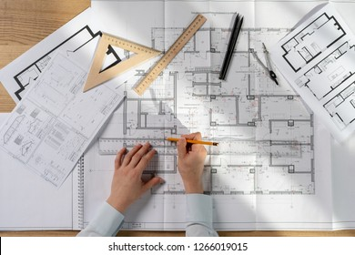 High angle above top view flat lay cropped busy lady in her formalwear shirt she sit at the desk in bright loft interior create new corporate project