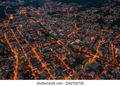 High angle aerial drone night shot of city street lights in Lugano, Switzerland