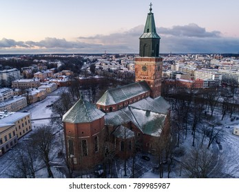 High angle aerial view of Cathedral of Turku at winter morning with city center in the background, Turku, Finland