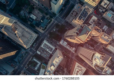 High angle aerial view of Chicago Downtown skyscrapers. Urban grid with streets. Warm light effect applied