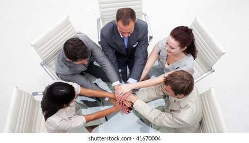 High angle of business people with hands together. Concept of teamwork