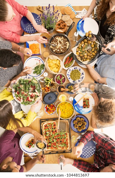 High Angle Friends Sharing Food Table Royalty Free Stock Image