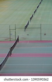 High angle full frame aerial view of a series of concrete and grass tennis courts in Mildura Australia